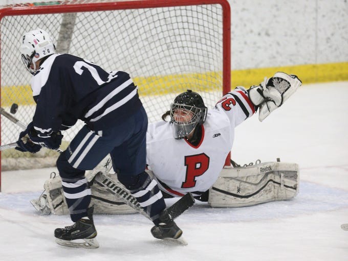 Penfield goalie Lindsay Browning, trying to make a