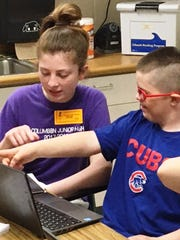 St. Columban student Millie Terselic enjoyed working with her brother Augie Terselic during the outreach day at Loveland Intermediate School May 2.