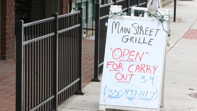 The Main Street Grille in North Canton is one of many businesses offering their customers carryout Tuesday, March 17, 2020. The community is socially distancing themselves to prevent the spread of the coronavirus.