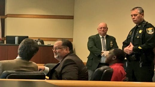 Terry Brady (in red jump suit) was sentenced to life in prison Monday, Nov. 7, 2016, for the 2014 death of a transgender woman.
