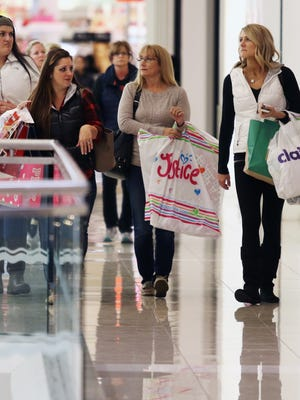 Photos by Cara Owsley/The Enquirer Barbara Ammerman, far left, and her sister-in-law Candice Ammerman, both of New Richmond, along with friends Julie Edmondson and Amanda Fry, both of Eastgate, were among the early shoppers hunting bargains on Black Friday at Kenwood Towne Centre.