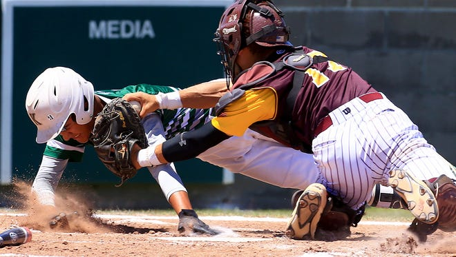King's Orlando Salinas gets tagged out at home against Harlandale on Saturday, May 6, 2017, at Cabaniss Baseball Field in Corpus Christi.