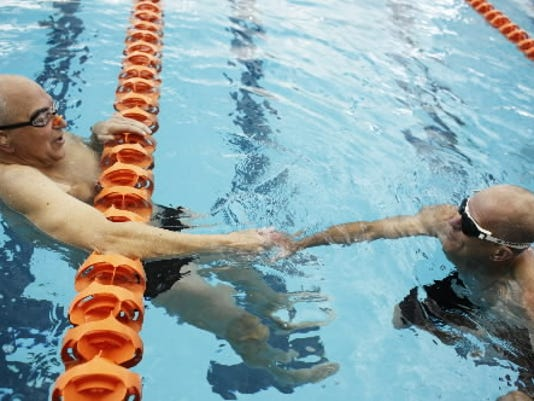 File photo; Swimmers shakes hands after their heat in the 2011 York County Senior Games. Experts this week talked about how fitness needs might or might not change with age.