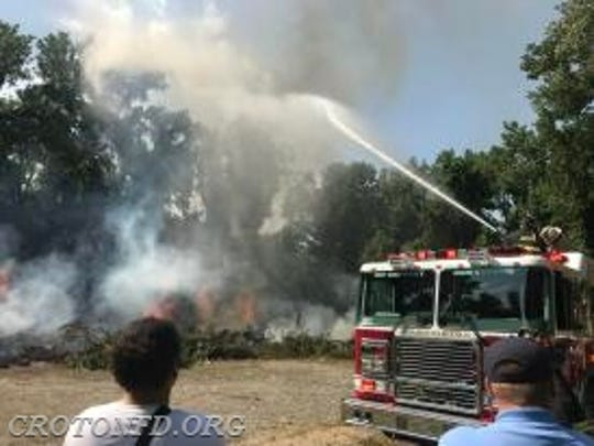 Croton firefighters wrestled with a brush fire in Croton