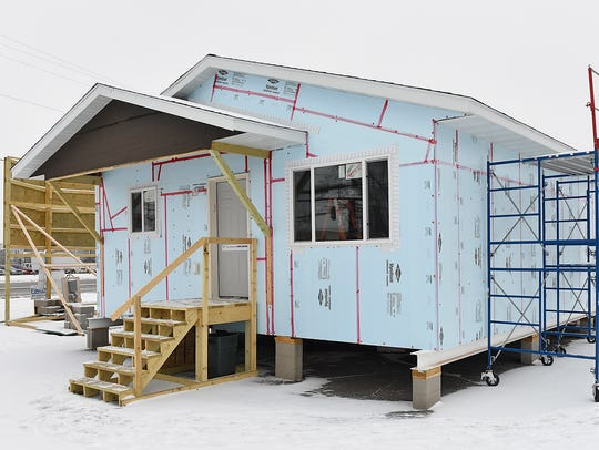 Technical High School students work on a new home that