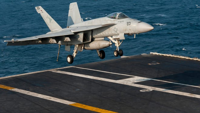 A Navy F-18 returns from a mission against Islamic State targets.