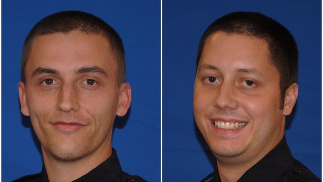 Officers Nick Hornback and Brandon Musgrove with the Springfield Township Police Department, from left to right.