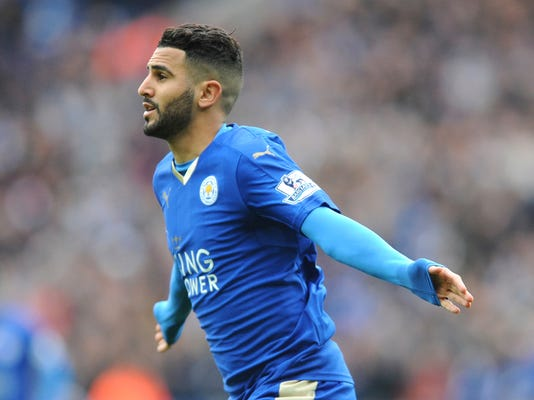 FILE - In this file photo dated Sunday, April 24, 2016, Leicesters Riyad Mahrez celebrates after scoring during he English Premier League soccer match against Swansea City at the King Power Stadium in Leicester, England.  Denied a chance for leave for new chances of glory at Manchester City, but Mahrez seems to be in a huff and won't be on the pitch at all upcoming Saturday. (AP Photo/Rui Vieira, FILE)