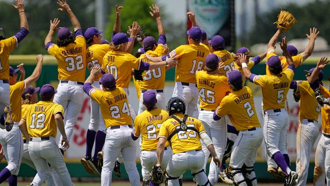 LSU players leap in the outfield after defeating UNC Wilmington at the Baton Rouge Regional of the NCAA college baseball tournament in Baton Rouge, La., Monday, June 1, 2015. LSU won 2-0 to win the tournament and advance to the super regionals.