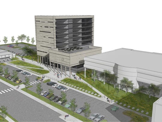 This conceptual drawing shows the current justice center to the right, with a nine-story tower that would be constructed to the north.