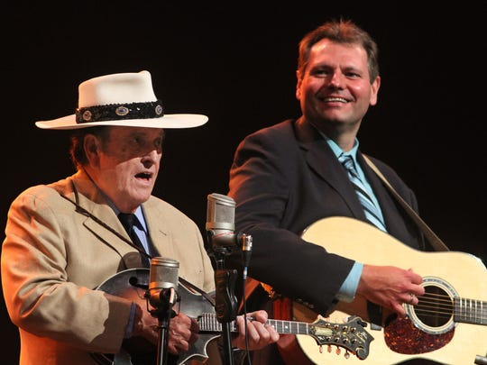 "Bobby Osborne, left, sings his classic ""Rocky Top"" at the Grand Ole Opry."