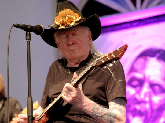 In this May 3, 2014, file photo, Johnny Winter performs at the 2014 New Orleans Jazz & Heritage Festival at Fair Grounds Race Course in New Orleans.