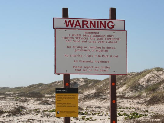 The four-wheel-drive sign on Padre Island National Seashore marks a spot beyond which visitors are warned they may encounter deep sand.