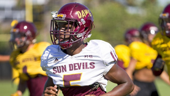 ASU defensive back Kobe Williams (5) warms up during practice at Kajikawa practice fields at Arizona State University in Tempe on August 24, 2017. Williams' helmet sports a 'DAWG' sticker. Defensive coordinator Phil Bennett likes to give his defenses nicknames.