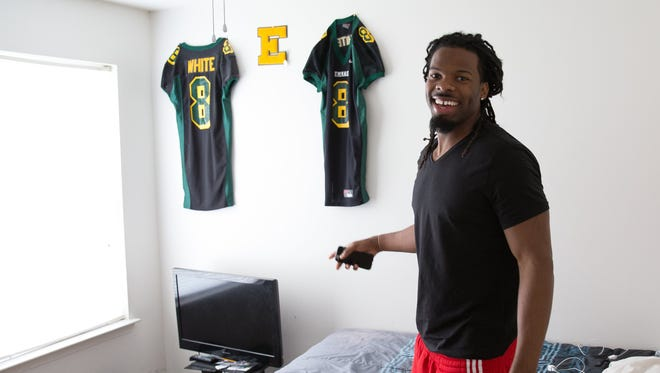 It took a while before Kevin White traded in his  old No. 8 for No. 11 at West Virginia.