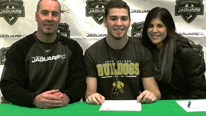 South Lyon senior Jack Dalzochio, a four-year varsity player, has committed to play club soccer at Albion. Flanked by his parents, Dalzochio played his entire club soccer career with the Michigan Jaguars.