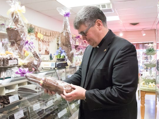 The Rev. Joseph Blenkle looks at a chocolate bunny at Alps Sweet Shop in Fishkill on Friday, April 7, 2017.