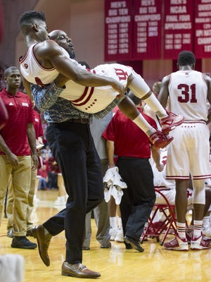 Indiana Hoosiers guard Robert Johnson (4) is carried off the court after suffering an apparent injury to his left ankle during an NCAA men's college basketball game at Indiana University's Assembly Hall in Bloomington, Ind., Saturday, Feb. 20, 2016. IU won, 77-73.