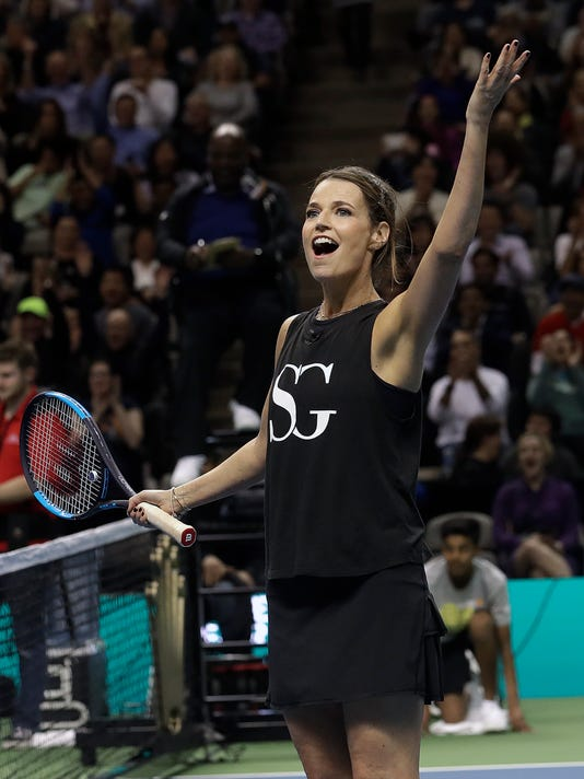 Savannah Guthrie waves during an exhibition tennis match with partner Jack Sock against Roger Federer and Bill Gates in San Jose, Calif., Monday, March 5, 2018. (AP Photo/Jeff Chiu)