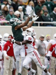 B.J. Cunningham, here hauling in a 37-yard pass against Indiana in 2011, holds MSU records for career receptions and yards.
