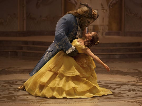 Dan Stevens as The Beast, left, and Emma Watson as