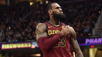 Cleveland Cavaliers forward LeBron James (23) reacts after a basket during the second half against the Detroit Pistons at Quicken Loans Arena.