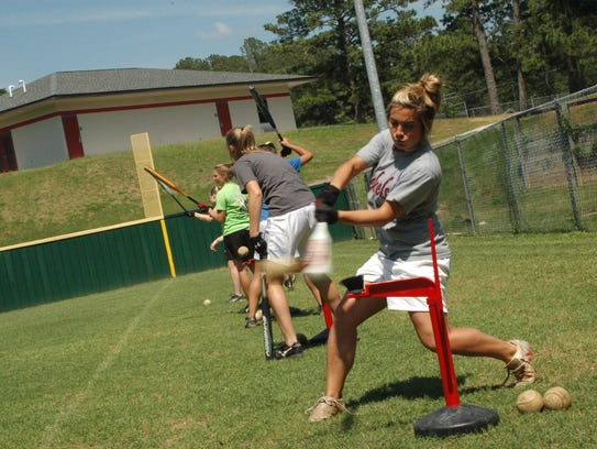 Frye takes her cuts at the tee during a Lady Rebels