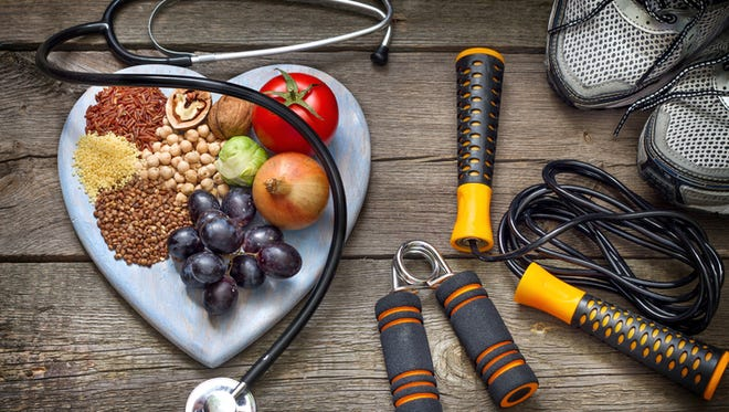 Exercise, fresh fruit and vegetables are part of a heart healthy lifestyle.