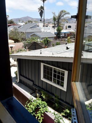 ANTHONY PLASCENCIA/THE STAR A vacation rental in the Pierpont neighborhood in Ventura is seen through the kitchen window of the Ulrich home. The Ulrichs are among a large number of area residents who feel the rentals are having a negative impact on the neighborhood.