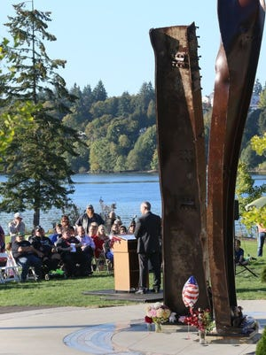 A small crowd gathers Sunday at Evergreen-Rotary Park to recognize the 15th anniversary of the Sept. 11 attacks.Steve Zugschwerdt / Special to the Kitsap Sun