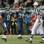 Quarterback Matt Hasselbeckof the Seattle Seahawks argues a call with referee Bill Leavy in Super Bowl XL at Ford Field on February 5, 2006 in Detroit, Michigan.