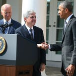 President Barack Obama shakes hands with Judge Merrick B. Garland, while Vice President Joe Biden stands nearby, after nominating him to the U.S. Supreme Court, in the Rose Garden at the White House in March in Washington, D.C.