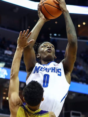 Memphis forward Kyvon Davenport (0), a junior-college transfer, is impressing teammates with his attitude as much as his skills.