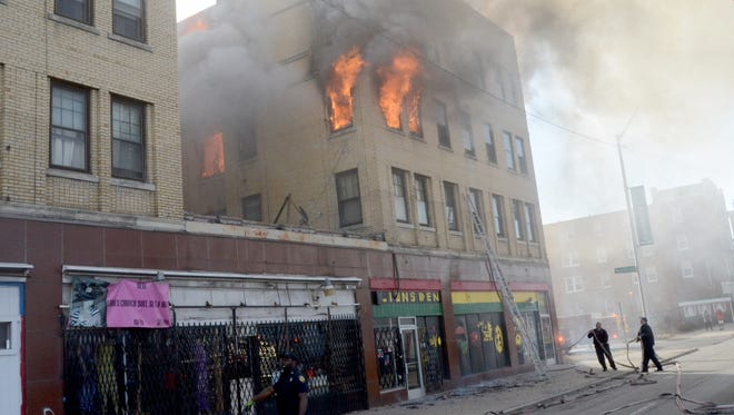 Firefighters from both the Detroit Fire Department and the Hamtramck Fire Department responded to the apartment building fire on Woodward Avenue and Woodland Street in Detroit on Saturday, March 17, 2018.