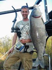 Bowfisherman John Overstreet shot his record 54-pound