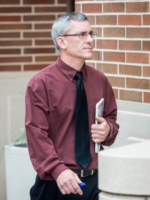 In this file photo, Matthew Puterbaugh, a former music teacher at the Dover Area School District, enters the York County Judicial Center.