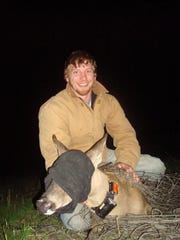 Murkowski poses with a buck captured while he was working