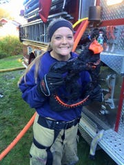 Pine Plains athlete Catie Gomm poses in her firefighter