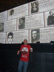 """Roger Waters fan Terry Makedon stands up against a wall at iintermission of a performance of """"The Wall."""""""