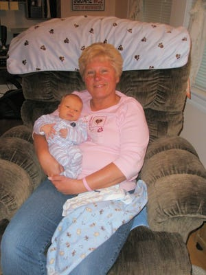 Diane Askew Mollan with her grandchild