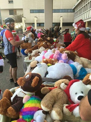 Cyclists deliver teddy bears and stuffed animals to kids at Driscoll Children's Hospital as part of a past Bay Area Bicycles Teddy Bear Bike Ride event.