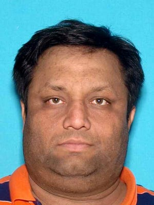 Amit Jain of New Jersey, faces  identitty thert and other charges in bank scam