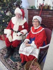 Jack and Joyce Daniels sit together, dressed as Santa