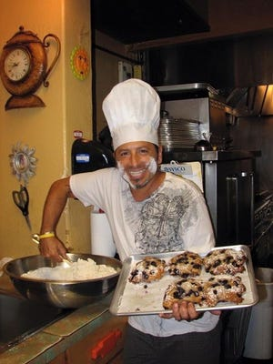 """Jerome """"The Muffin Man"""" Tocio and his wife, Theresa, will offer free muffins on Monday, at the Sunburst Cafe."""