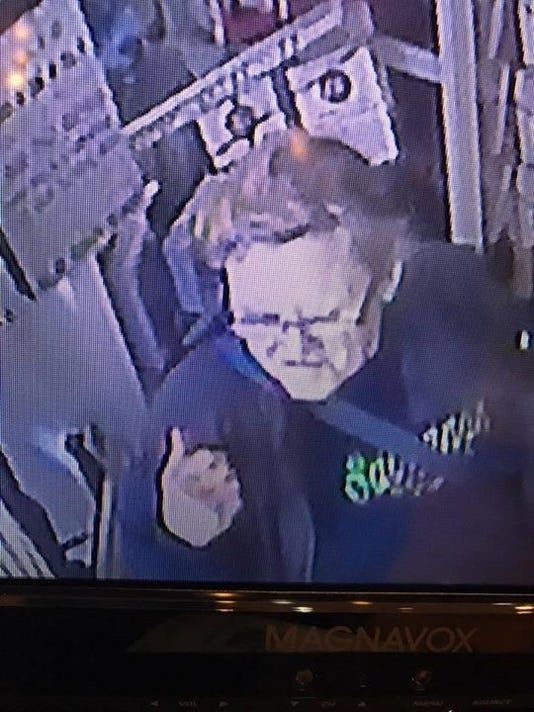 MTO purse theft - wearing glasses