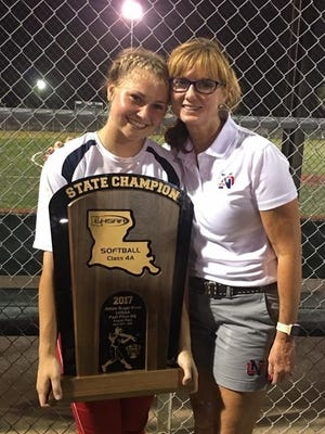 District 1-4A MVP E.C. Delafield of North DeSoto holds up the 2017 LHSAA Class 4A state championship trophy with Lady Griffins coach Lori McFerren.