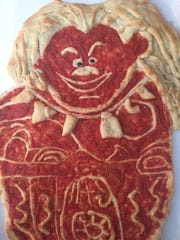 Maui, a character from the Disney movie Moana, is one of the pizza art characters created by Brian Clossen at Little Italy Pizzeria in Townsend.