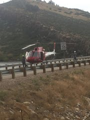 An emergency helicopter lands at the scene of a fatal