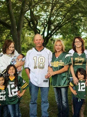 This month, Chuck Wickert (second from left) and his family found the two women who saved his life at a Green Bay Packers game in 2000. It took the family 17 years to find the women they call their angels.