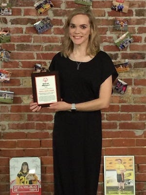 Senior-Junior Forum Novice Chair Amber Meadows accepts a special award On behalf of SJF at the Special Olympics North Texas Area Sports Banquet. SJF supports Special Olympics through volunteer work and donating a portion of the Red River Wine and Beer Festival proceeds.